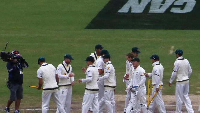 Australia's team celebrate after winning the second Ashes cricket test against England at the Adelaide Oval