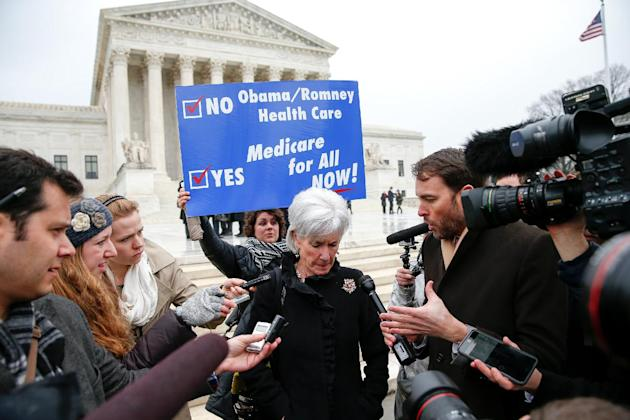 Former Health and Human Services Secretary Kathleen Sebelius speaks with reporters outside the Supreme Court in Washington, Wednesday, March 4, 2015. The Supreme Court heard arguments in King v. Burwe