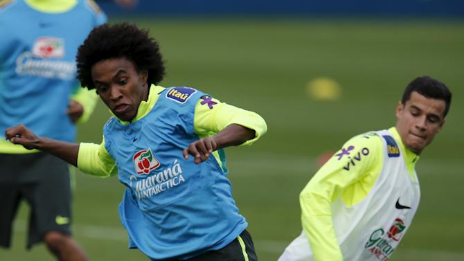 Brazilian national soccer player Willian challenges his teammate Philippe Coutinho during a training session in Teresopolis