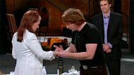 Pierre Pelletier, a former owner, rubs some of Olivier's products on Arlene Dickinson's arm during an episode of the Dragons' Den. A group of five investors bought the company in April.