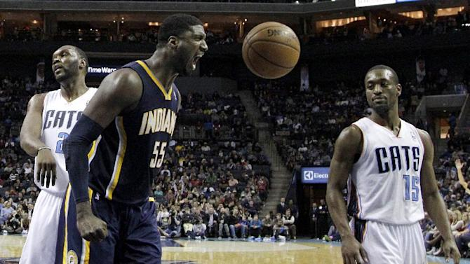 Indiana Pacers' Roy Hibbert (55) reacts after making a basket as Charlotte Bobcats' Kemba Walker (15) stands by during the second half of an NBA basketball game in Charlotte, N.C., Wednesday, Nov. 27, 2013. The Pacers won 99-74