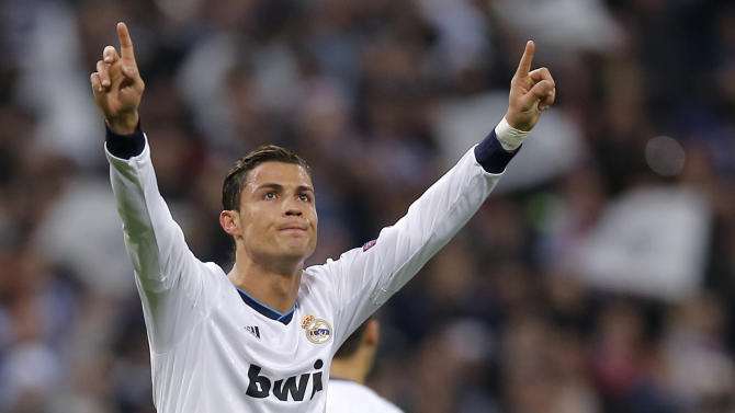Real Madrid's Cristiano Ronaldo from Portugal celebrates scoring during the Champions League round of 16 first leg soccer match between Real Madrid and Manchester United at the Santiago Bernabeu stadium in Madrid, Wednesday Feb. 13, 2013. (AP Photo/Daniel Ochoa de Olza)