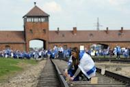 Young Jews place memory plaques on railway tracks at the Auschwitz Nazi death camp in Oswiecim, southern Poland, at a ceremony on April 19. England's footballers will visit the former Nazi death camp at Auschwitz in southern Poland as well as Oskar Schindler's factory in Krakow during Euro 2012, the Football Association (FA) confirmed Tuesday