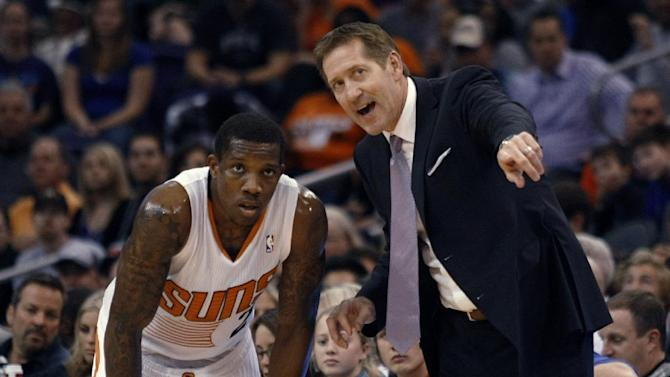 Phoenix Suns coach Jeff Hornacek, right, talks to Eric Bledsoe during the third quarter of an NBA basketball game against the Philadelphia 76ers on Saturday, Dec. 28, 2013, in Phoenix