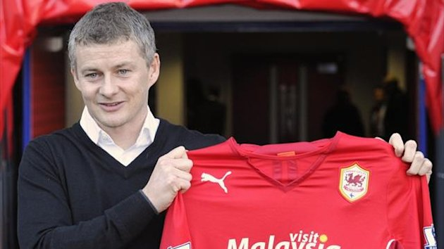 Ole Gunnar Solskjaer holds a club shirt as he is officially unveiled as the new manager of Premier League side Cardiff City (Reuters)