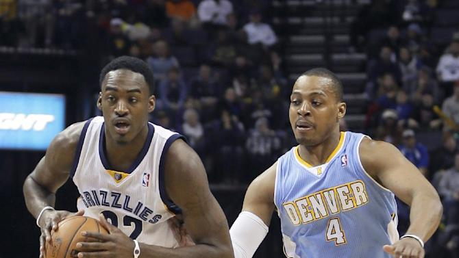 Memphis Grizzlies' Ed Davis (32) moves the ball ahead of Denver Nuggets' Randy Foye (4) during the second half of an NBA basketball game in Memphis, Tenn., Saturday, Dec. 28, 2013. The Grizzlies defeated the Nuggets 120-99