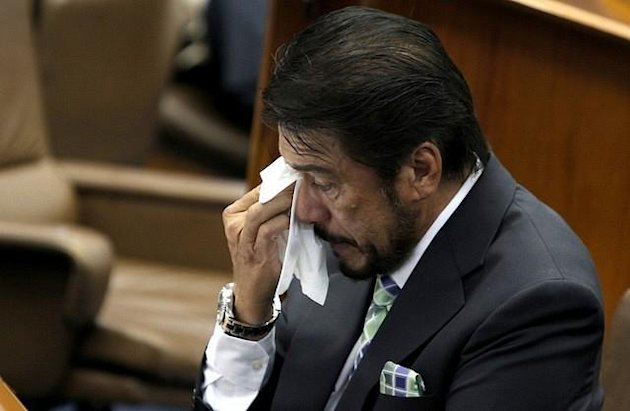 Senate President Juan Ponce Enrile and Senator Ramon 'Bong' Revilla Jr. console Majority Floor Leader Vicente 'Tito' Sotto III after he became emotional while delivering his Turno en Contra on the Reproductive Health (RH) bill during session, Monday, August 13, 2012. Sotto was in tears as he told the story of his first-born son who died five months after birth. (Joseph Vidal, Senate Pool, NPPA Images)Full speech here: Turno en Contra SB 2865