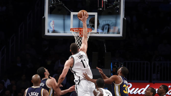 Brooklyn Nets' Brook Lopez (11) dunks against against the Utah Jazz during the first half of an NBA basketball game Tuesday, Nov. 5, 2013, in New York