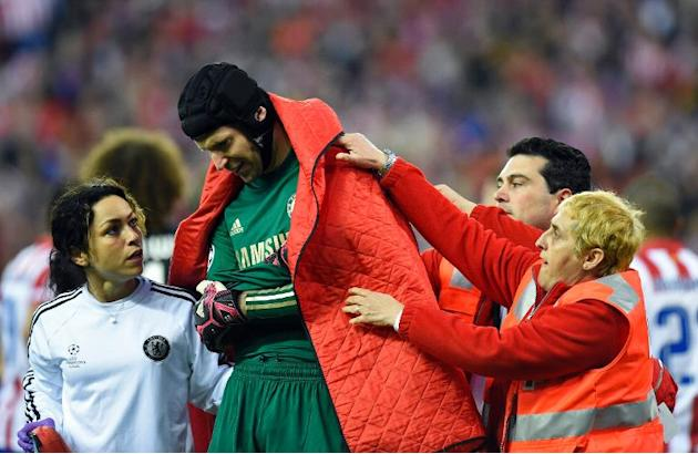 Chelsea's Czech goalkeeper Petr Cech leaves the pitch due to an injury during the UEFA Champions League semifinal first leg football match Club Atletico de Madrid vs Chelsea FC at the Vicente Cald