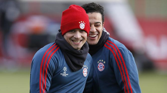 Bayern's Thiago Alcantara of Spain, background, jokes with team mate Xherdan Shaqiri of Switzerland during a last training session prior the Champions League group D soccer match between FC Bayern Munich and Manchester City, in Munich, southern Germany, Monday, Dec. 9, 2013. Munich will face Manchester Tuesday