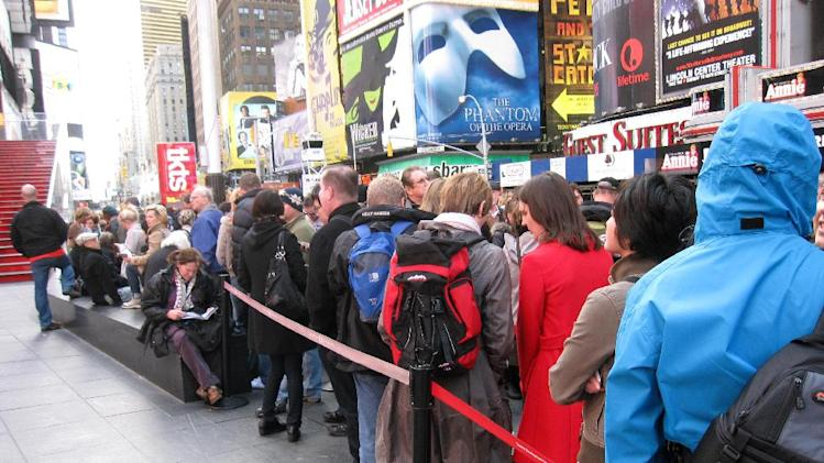A line of ticket-buyers wait at the TKTS booth, which sells discount tickets to Broadway shows,  in New York's Times Square on Wednesday, Oct. 31, 2012. Most Broadway theaters were reopening Wednesday for regular matinee and evening performances following several days of closures related to superstorm Sandy. (AP Photo/Beth J. Harpaz)