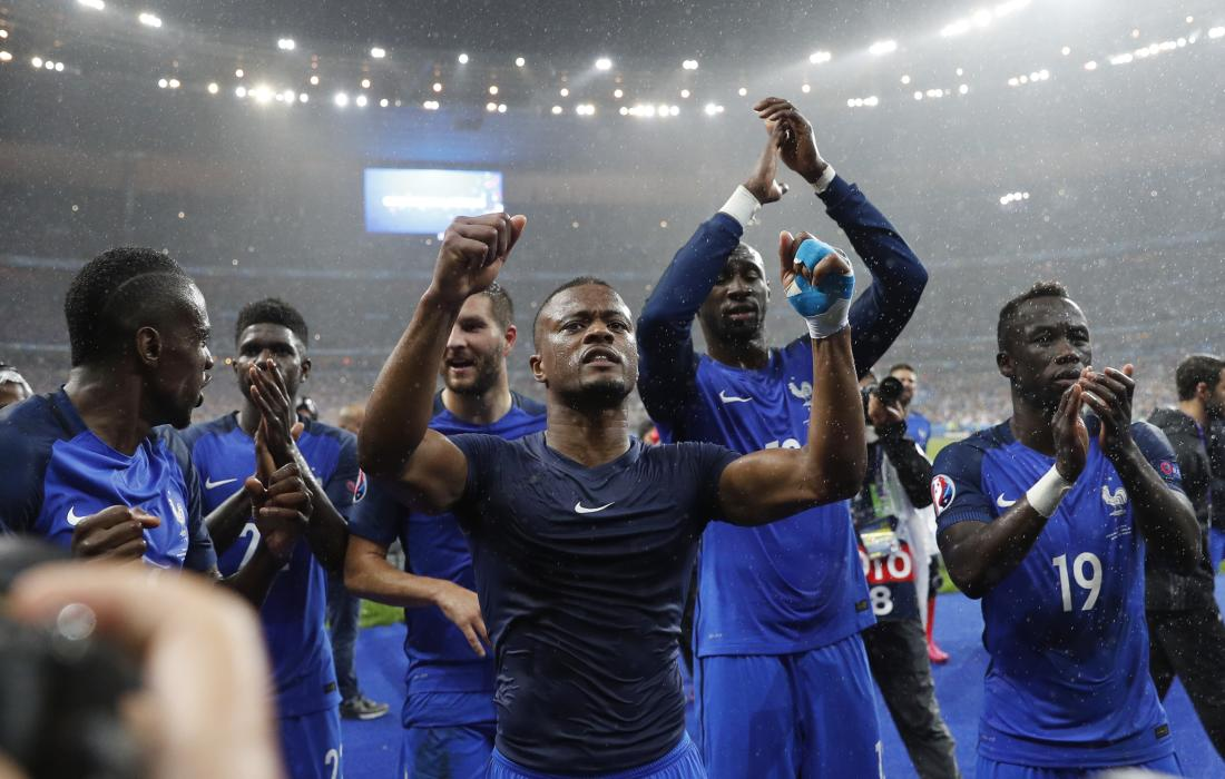 France's Patrice Evra and teammates celebrate after the game