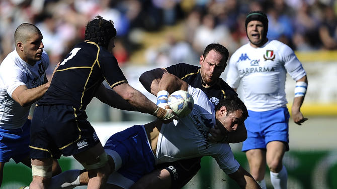 Italy  Andrea Masi (C) is tackled by Scotland's Graham Morrison during their Rugby Union Six Nations match at the Rome's Olympic stadium on March 17, 2012. Italy defeated Scotland 13-6.  AFP PHOTO / FILIPPO MONTEFORTE (Photo credit should read FILIPPO MONTEFORTE/AFP/Getty Images)
