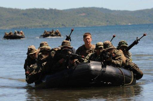 US and Filipino soldiers are seen on a boat during a joint mock beachfront assault
