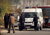"""Chinese police near Ai Weiwei's studio in Beijing. The dissident artist has accused Chinese authorities of trying to """"crush him"""" after he was barred from a hearing challenging a multi-million-dollar tax penalty against a firm he founded"""
