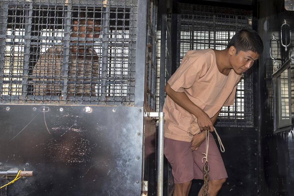 Myanmar migrant workers Zaw Lin and Win Zaw Htun arrive at the Koh Samui Provincial Court, in Koh Samui, Thailand