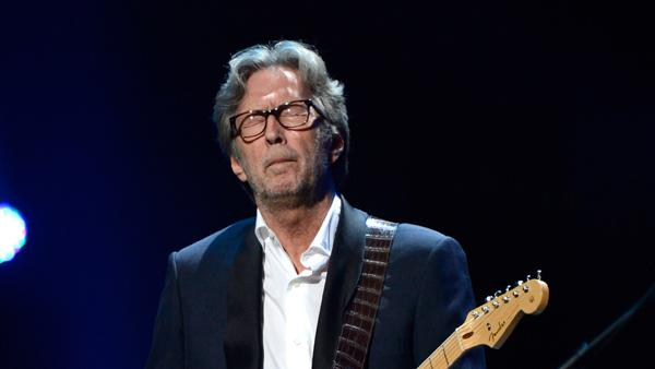 "Eric Clapton performs at ""12-12-12"", a concert benefiting The Robin Hood Relief Fund to aid the victims of Hurricane Sandy."