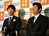 """Japan's Osaka Mayor Toru Hashimoto (L), accompanied by Osaka Governor Ichiro Matsui (R), speaks to reporters in Tokyo in April 2012. The 42-year-old former corporate lawyer thinks Japan needs a dictatorship. One survey found 55 percent of voters want his party Osaka Isshin no Kai (Osaka Renewal Party) to win """"an influential number of seats"""" in the next general elections"""