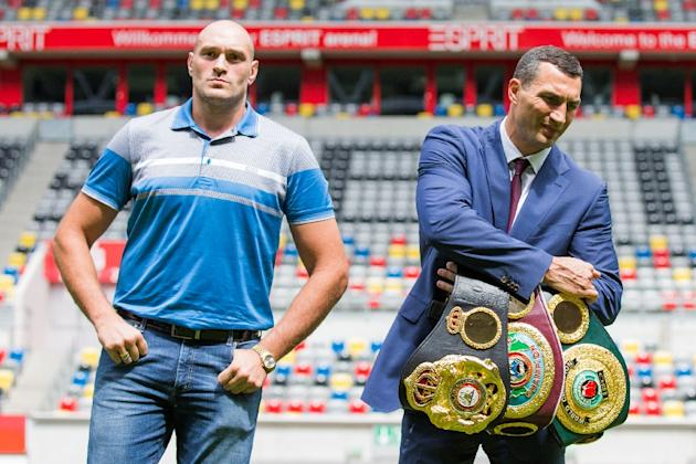 Ukrainian heavyweight boxing champion Wladimir Klitschko (right) and his British challenger Tyson Fury at a press conference at the Espri Arena stadium in Duesseldorf, western Germany, on July 21, 201