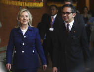 U.S. Secretary of State Hillary Rodham Clinton, left, walks with Indonesian Foreign Minister Marty Natalegawa at the Joint Commission Meeting between Indonesia and U.S. in Nusa Dua, Bali, Indonesia, Sunday, July 24, 2011. (AP Photo/Dita Alangkara, Pool)
