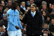 "Manchester City's Mario Balotelli (L) shares a joke with manager Roberto Mancini when coming on as a substitute during the FA Cup third-round clash against Watford on January 5, 2013. Mancini admitted he will be disappointed to see ""one of my children"" Balotelli leave Manchester for AC Milan but insists the move is in the best interests of the Italy forward"