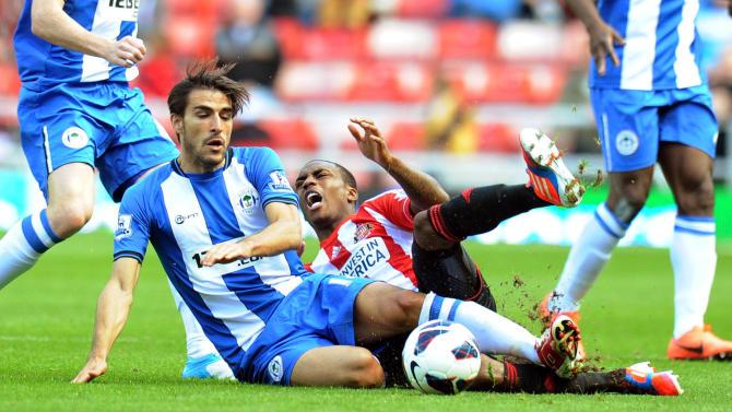 Wigan's Jordi Gomez, left, was sent off in the second half