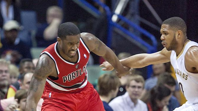 Portland Trail Blazers guard Wesley Matthews (2) works against New Orleans Pelicans guard Eric Gordon (10) in the second half of an NBA basketball game in New Orleans, Friday, March 14, 2014. The Trail Blazers won 111-103