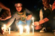 Bangladeshi social activists light candels in Dhaka on February 11, 2013, as they take part in seven days of protest calling for quick executions of the 10 alleged war criminals currently being tried on such charges as genocide and rape