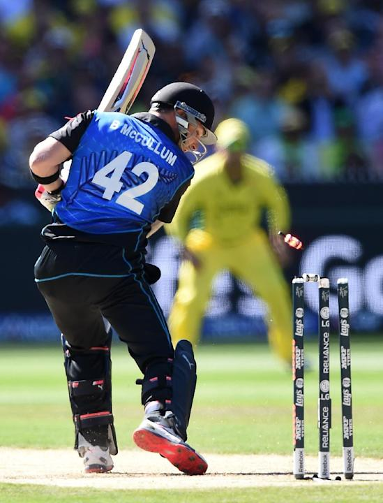 New Zealand captain Brendon McCullum is bowled for no score by Australia's Mitchell Starc during the Cricket World Cup final in Melbourne, Australia, Sunday, March 29, 2015. (AP Photo/Andy Brownbi