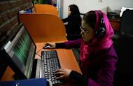 Employees are pictured working at Awaz, the private company that owns Globox.tv, in Kabul on January 30, 2013. Globox.tv is the latest product of a media revolution in Afghanistan since the fall of the Taliban regime and the station's bosses hope its bold programmes will attract younger viewers