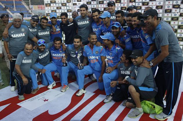 Indian cricket team after winning the 3rd ODI against West Indies at Green Park Stadium in Kanpur on Nov.27, 2013. (Photo: IANS)