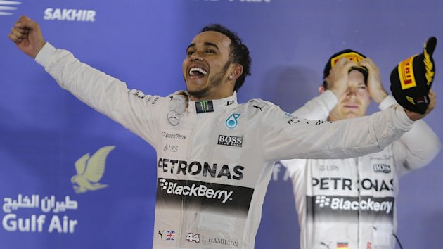 Lewis Hamilton of Britain celebrates on the podium after winning in Bahrain (Reuters)