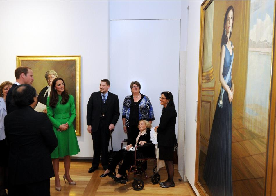 Catherine, Duchess of Cambridge, and Britain's Prince William look at a portrait during a visit to the National Portrait Gallery in Canberra