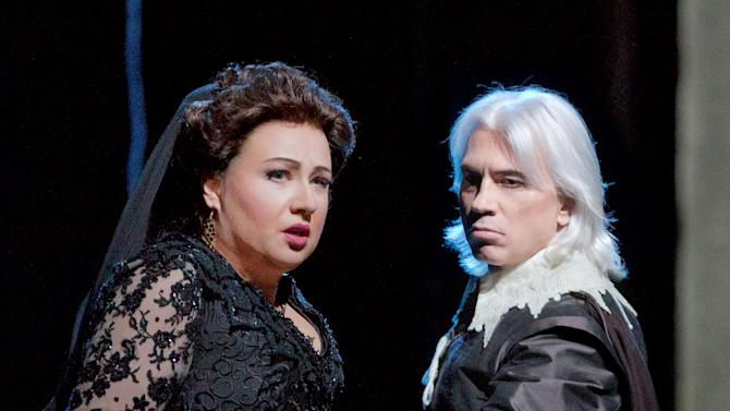 "In this Feb. 14, 2013 photo provided by the Metropolitan Opera, Anna Smirnova plays Ebolige and Dmitri Hvorostovsky as Rodrigo during a dress rehearsal of ""Don Carlo"" at the Metropolitan Opera in New York. (AP Photo/Metropolitan Opera, Ken Howard"