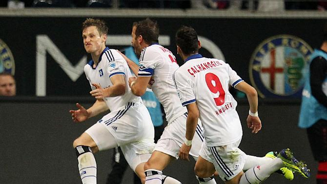 Hamburg's Marcell Jansen, left, celebrates his side's equalizing goal during a German soccer Bundesliga match between Eintracht Frankfurt and Hamburger SV in Frankfurt, Germany, Saturday, Sept. 28, 2013