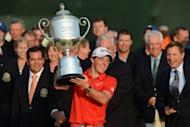 Rory McIlroy of Northern Ireland holds the trophy after winning the 94th PGA Championship, on August 12, on Kiawah Island, South Carolina. McIlroy blitzed the field on a marathon Sunday, claiming his second major title with a record-setting eight-shot victory on the wind-swept Ocean Course