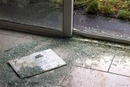 Broken glass is scattered over the floor in the show home on the Glenall housing estate in the village of Borris-in-Ossory, County Laois, Ireland February 13, 2013. REUTERS/Cathal McNaughton
