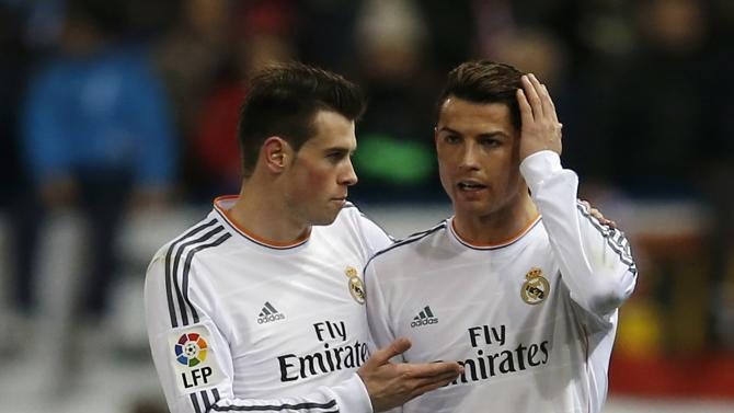 Real Madrid's Ronaldo listens to his team mate Bale during their Spanish King's Cup semi-final second leg soccer match against Atletico Madrid in Madrid