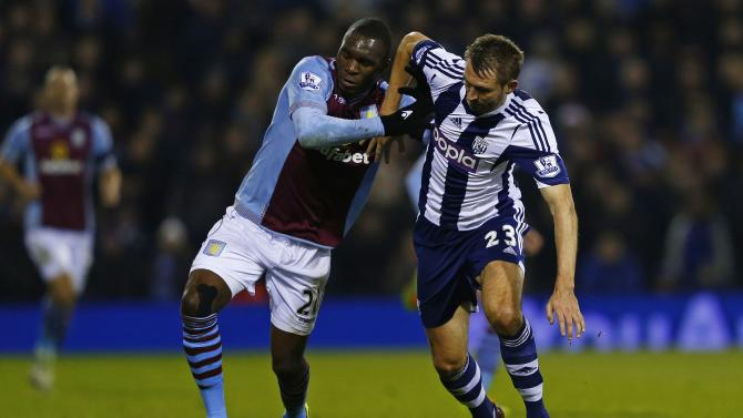 West Bromwich Albion's Gareth McAuley challenges Aston Villa's Christian Benteke during their English Premier League soccer match at The Hawthorns in West Bromwich