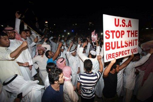 Kuwaitis protest against a film deemed offensive to Islam near the US embassy in Kuwait City. About 500 demonstrators gathered Thursday waving a black Al-Qaeda flag