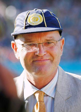 Former New Zealand cricketer Martin Crowe accepts a cap as induction into the ICC Cricket Hall Of Fame in Auckland
