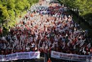 People in Madrid take part in a demonstration against government austerity measures aimed at slashing the public deficit and avoiding the need for a financial bailout, on September 15. The demonstrators gathered in groups along the central streets of the Spanish capital ahead of the rally which gets underway at noon at the Plaza Colon square which is expected to draw tens of thousands