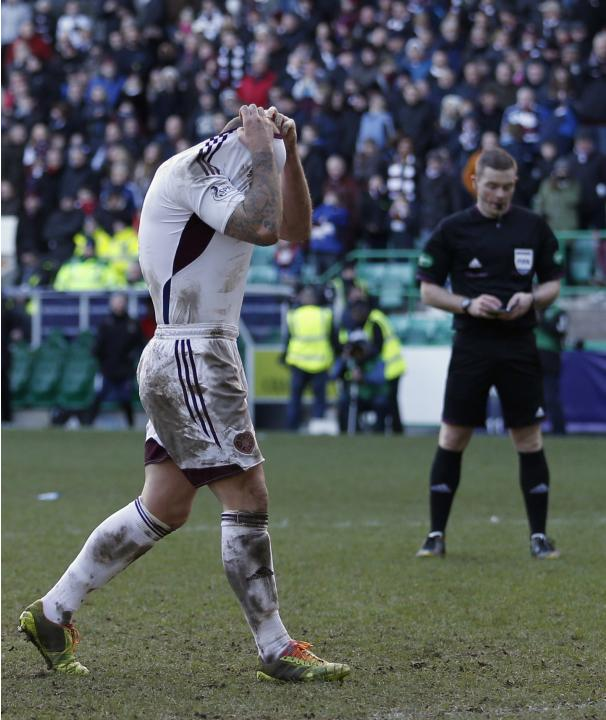 Hearts' Hamill hides his head after he missed a penalty against Inverness Caledonian Thistle during their Scottish League Cup semi final soccer match at Easter Rd Stadium in Edinburgh