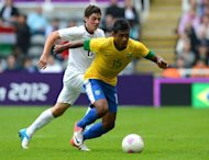 Brazil's defender Alex Sandro (R) vies with New Zealand's forward Marco Rojas during the London 2012 Olympic Games men's football match between Brazil and New Zealand at St James' Park in Newcastle, north-east England. Brazil beat New Zealand 3-0