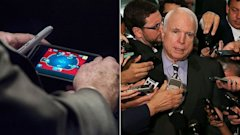 gty gty mccain phone split kb 130904 16x9 608 John McCains Poker Playing Is Wholesome Compared to The Internet Transgressions of Other Pols