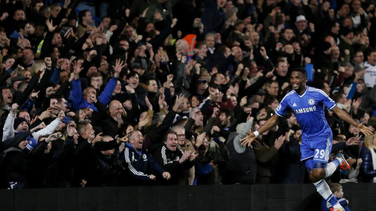 Chelsea's Eto'o celebrates after scoring his third goal during their English Premier League soccer match against Manchester United at Stamford Bridge