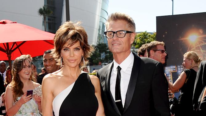 From left, Lisa Rinna and Harry Hamlin arrive at the 2013 Primetime Creative Arts Emmy Awards, on Sunday, September 15, 2013 at Nokia Theatre L.A. Live, in Los Angeles, Calif. (Photo by Scott Kirkland/Invision for Academy of Television Arts & Sciences/AP Images)
