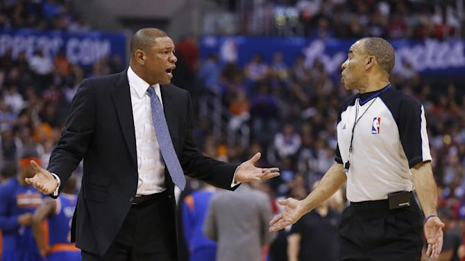 Los Angeles Clippers coach Doc Rivers talks with official Dan Crawford after Chris Paul was called for a technical foul during the first half of an NBA basketball game against the New York Knicks in Los Angeles, Wednesday, Nov. 27, 2013. The Clippers won 93-80