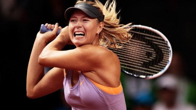 Tennis - Sharapova fights back to make Madrid semis