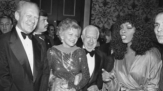 "FILE - In this Nov. 2, 1979 file photo, Gerald and Betty Ford, left, Donna Summer, right, and Cedars-Sinai Medical Center board chairman Steve Broidy at a reception prior to gala disco party benefit in Beverly Hills, Calif.  Summer, the Queen of Disco who ruled the dance floors with anthems like ""Last Dance,"" ""Love to Love You Baby"" and ""Bad Girl,"" has died. Her family released a statement, saying Summer died Thursday, May 17, 2012. She was 63. (AP Photo/Reed Saxon, File)"